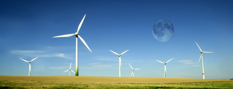 Wind turbines farm with full moon. Alternative energy source.